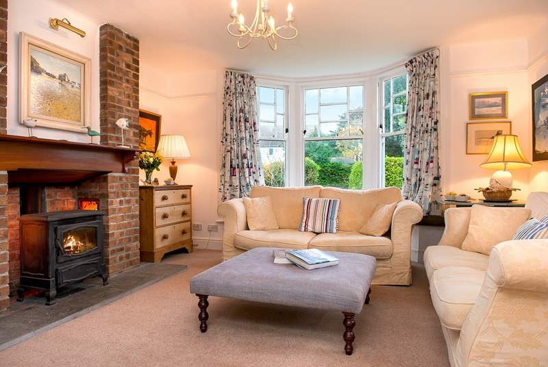The comfy sitting-room has a lovely wood-burner making this an ideal retreat all year round.