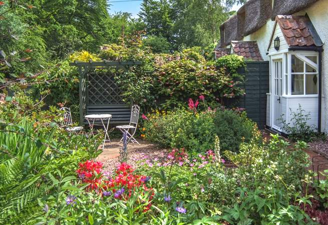 The cottage is embraced by its wonderful garden - an absolute delight of colour and variety.