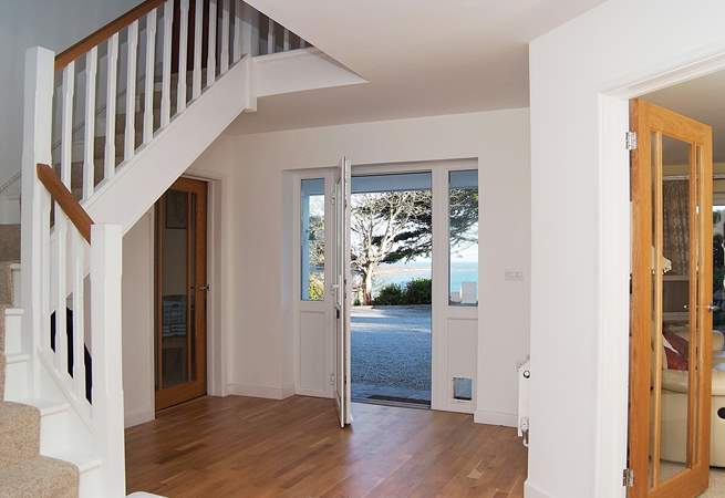 Glass doors to all the downstairs rooms enhance the sense of space and light throughout the house.