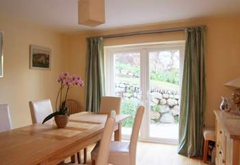 The separate dining-room also has doors opening out to the back garden.