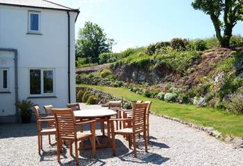 The gravelled patio is a sunny, sheltered spot ideal for enjoying meals outside.