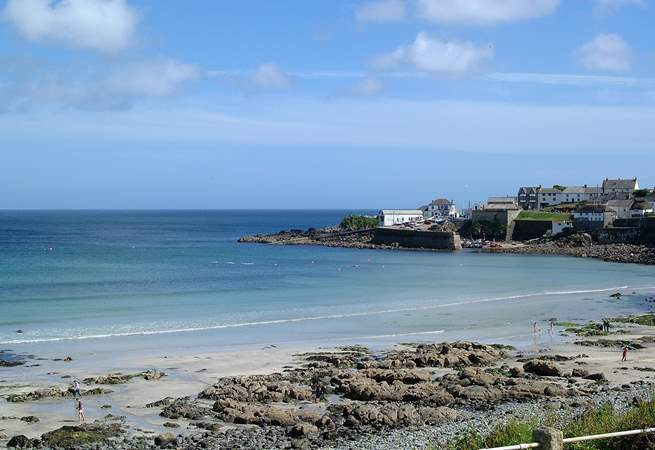 Coverack beach is sandy at low tide.
