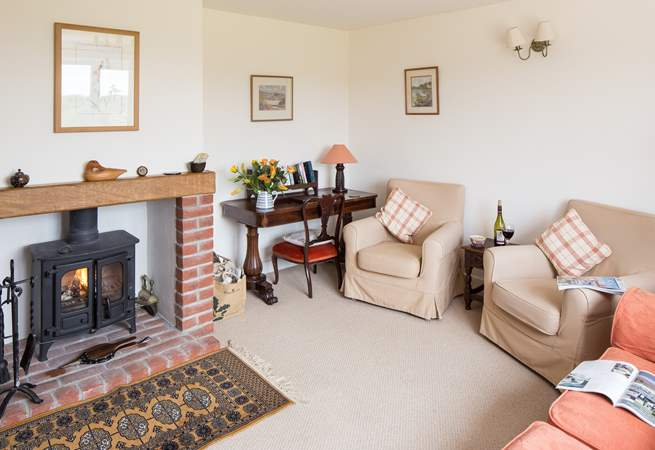 The sitting-room has a cosy wood-burner, making this a great place to stay all year round.