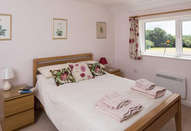 The second double bedroom is just as spacious as the first, with far-reaching rural views across the garden.