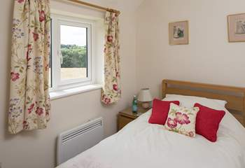 The single bedroom, bedroom 3, also looks out over open countryside.