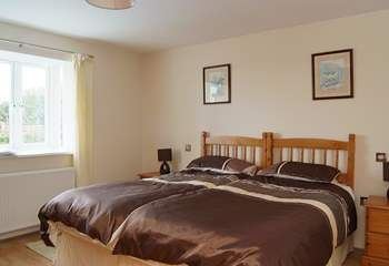 On the ground floor, bedroom 1 is furnished with versatile 'zip and link' (double or twin) beds.