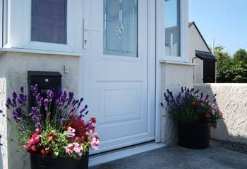In summer there are colourful pots of flowers either side of the front door.