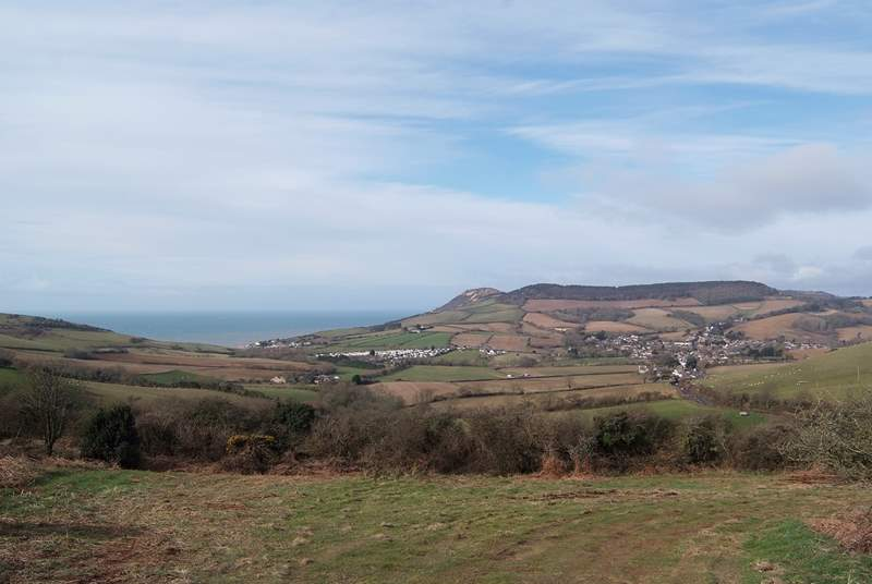 The panoramic view across the valley from a local footpath. The Linhay is amongst the nearest group of buildings and Chideock village is to the right.