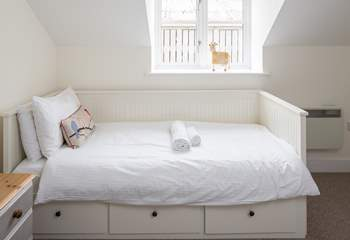 The third bed in bedroom 2 is a 'day bed', but just as comfortable as the twin beds.
