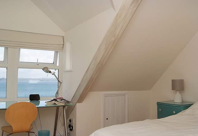 The second floor bedroom has a desk with stunning views to the sea.