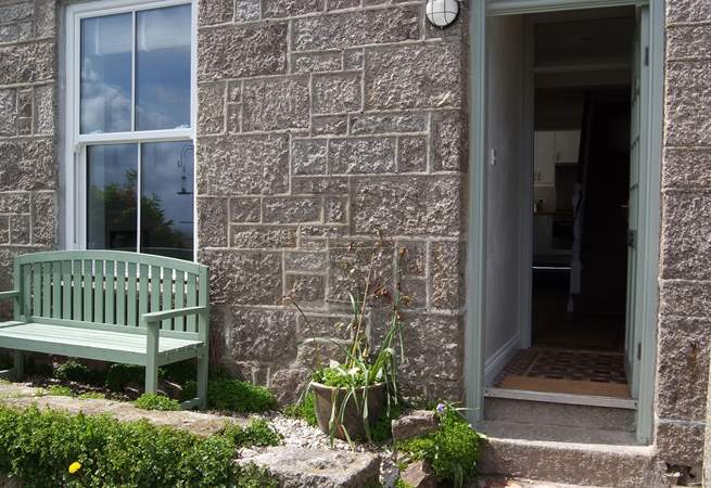 Relax in front of the cottage and take in the fabulous views.