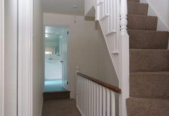 The first floor landing leads to the bathroom and very steep stairs go up to the second floor bedroom.