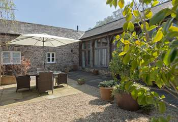 The courtyard seating-area captures the sunshine for most of the day and has been made to feel very private and sheltered with attractive planting.
