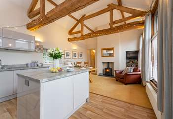 A sleek modern kitchen gives this characterful barn conversion a contemporary feel.