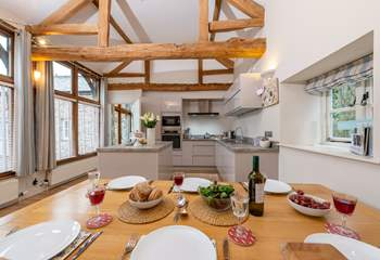 There is a high ceilinged open plan kitchen/dining-room.