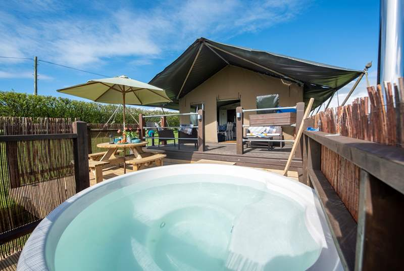 The raised deck is perfect for sitting back and relaxing on, whether in or out of the blissful hot tub.