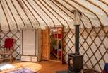Double doors lead from the main yurt through to the 'baby' yurt.