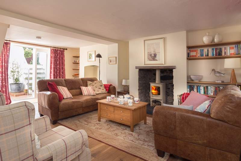 There is a wonderfully cosy sitting-room with French windows out to the patio and garden.