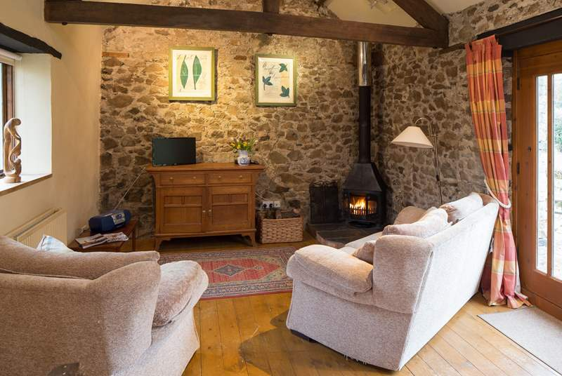 Cosy living room with wood-burner.