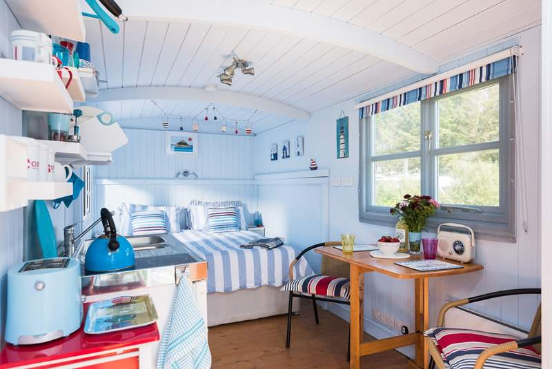 This deligjhtful hut is surprisingly spacious inside with room at either side of the king-sized bed.