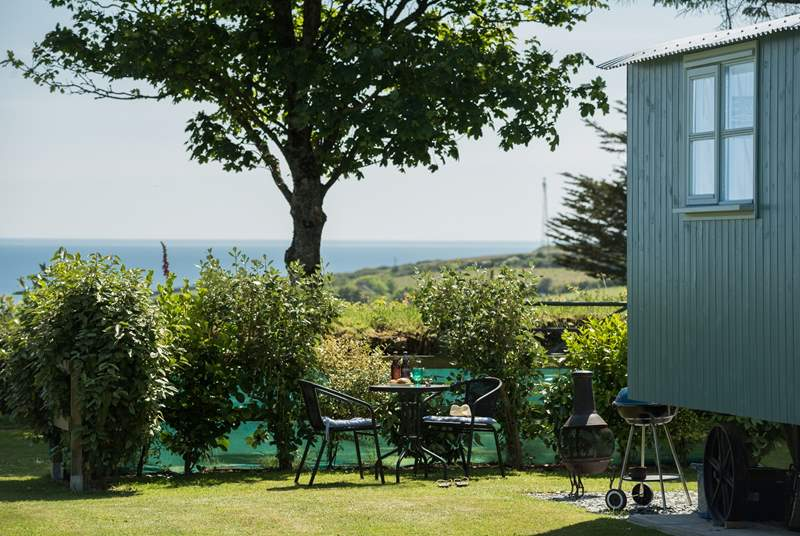 Mr Blue Sky sits in his spacious plot looking straight out to sea with his sister Forget Me Not next door (there is a hedge between them to ensure privacy). Please note, the barbecue and chiminea have been replaced with a fire-pit barbecue.