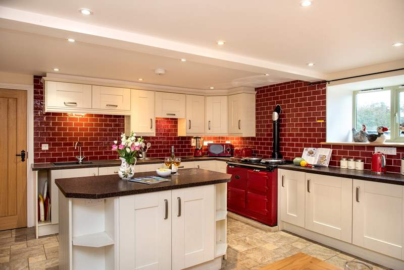 A fabulous large farmhouse kitchen, complete with an Aga.