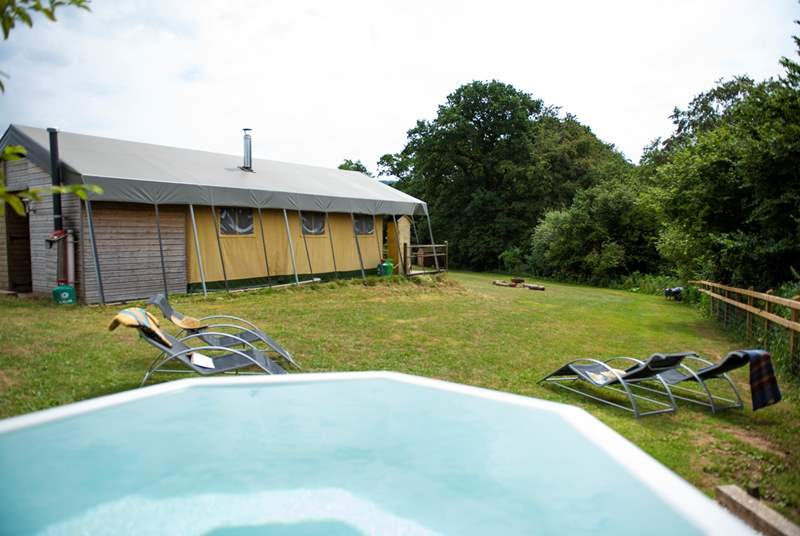 Beaver's Lodge and its wood-fired hot tub sit at the top of a gentle slope.