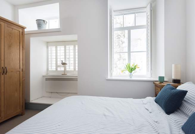 The bedrooms are to the rear of the apartment but the double-aspect windows bring in the light.