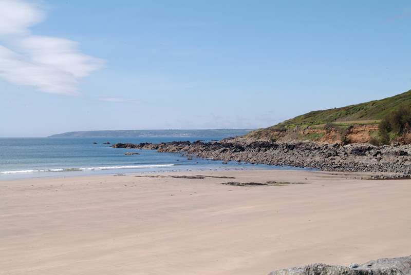 Perranuthnoe beach, seen here at low tide, is just a short drive or stomp across fields from the cottage.