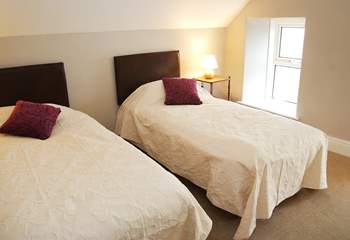 Two of the single beds in the loft room can be joined to make a king-size double bed.