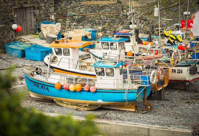 The fishing boats sit in the cove after returning with their catch, pop into the fish shop to see what came in today.