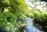 The River Kensey babbles along the bottom of the meadow (it is fenced off for safety but please take care with children).