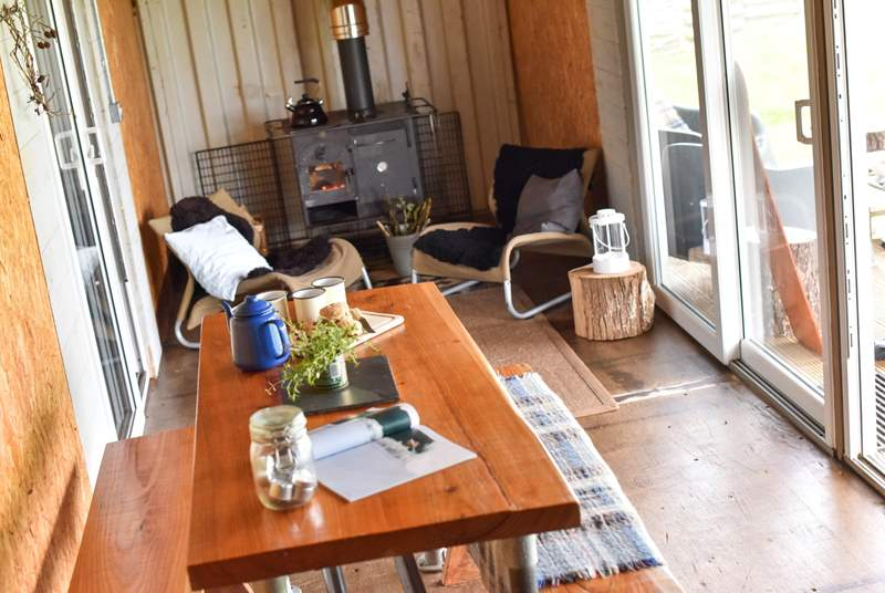 The living-room makes the most of the country views from the bespoke table and cosy sitting-area.