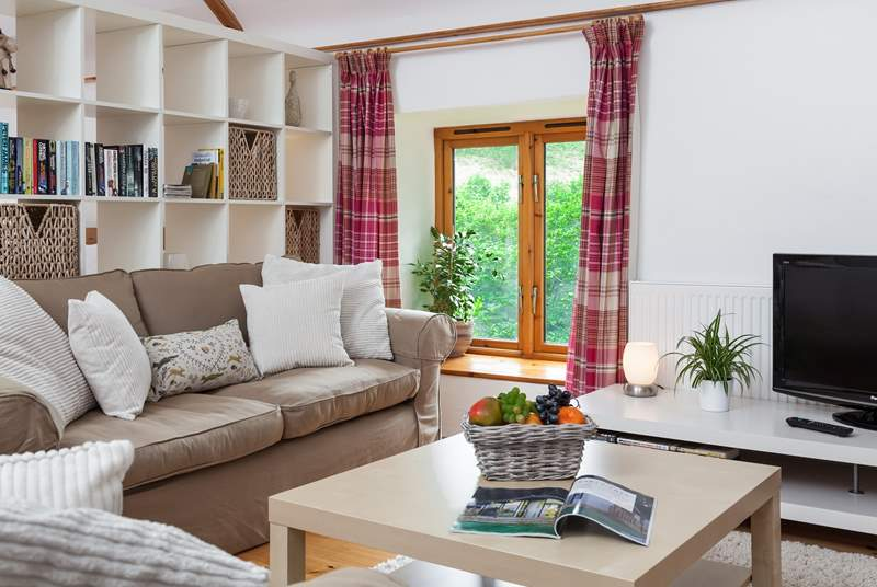 Lovely natural light pours in from the windows, bringing the outside very much in!
