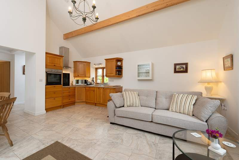 Ashey Barn has a spacious open plan living area, with the kitchen in one corner.