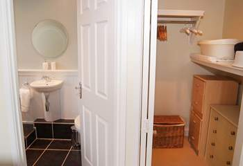 With a walk-in closet next to the en suite bathroom...