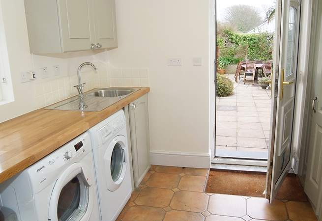 The utility-room and shower-room next door are perfect for washing off after a day on the beach.
