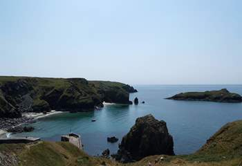 Looking down at Mullion harbour from up on the coastal footpath outside the renowned Mullion Cove Hotel.