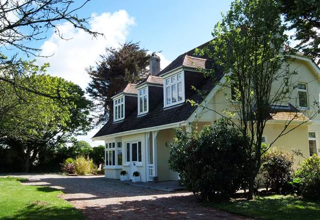 Tregwyth is a majestic looking house surrounded by gardens.
