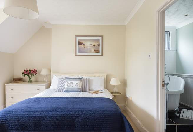 This lovely bedroom has a gorgeous en suite bathroom and a walk-in closet.