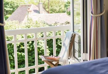 Choose a book from the library and take a seat on the balcony.