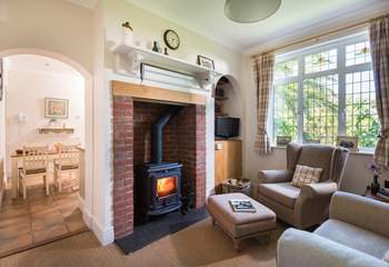 The snug offers a sanctuary to relax and maybe read a book in front of the wood-burner.