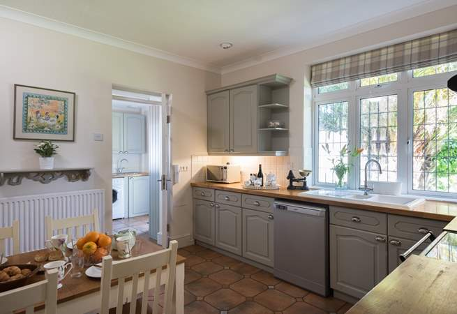 The kitchen has a walk-in pantry and door through to the utility-room and downstairs shower-room.