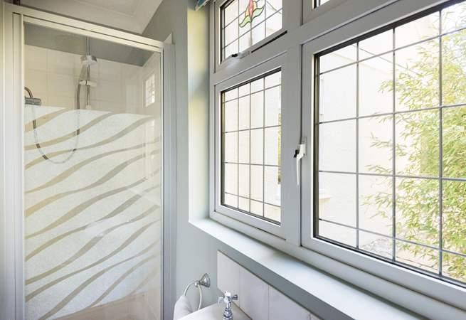 The ground floor shower-room is found just beyond the kitchen.