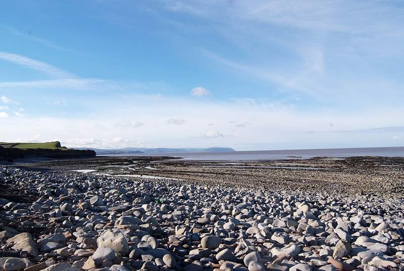 This is the beach at Kilve, an extraordinary part of the Area of Outstanding Natural Beauty. Explore the rocks for fossils, or follow the cliff path.