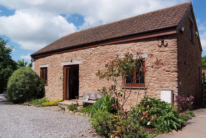 Headford Farm cottage is a very spacious barn conversion on a friendly working farm. The courtyard garden is at the back and the two paddocks for you to use are to the left.