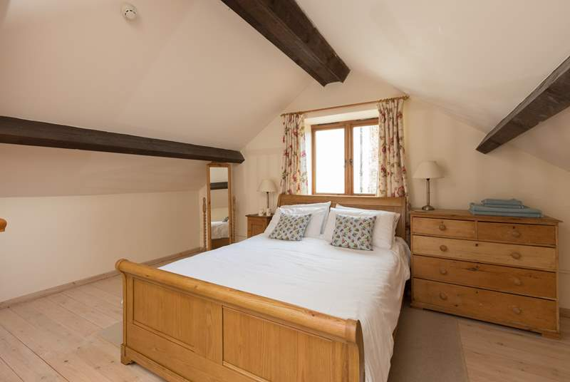 The mezzanine-area is the bedroom, with this lovely king-size sleigh bed.