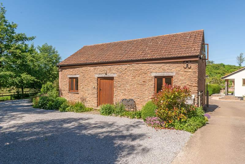 Headford Farm cottage is a very spacious barn conversion on a friendly working farm. The courtyard garden is at the back, and the two paddocks for you to use are to the left.