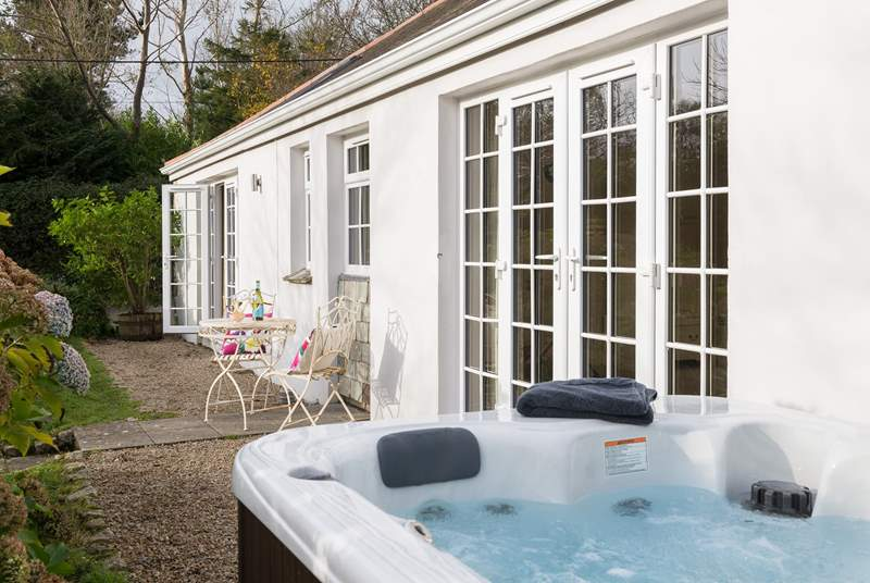 French doors lead out from the bedroom to the hot tub so you can just pop out and jump in!