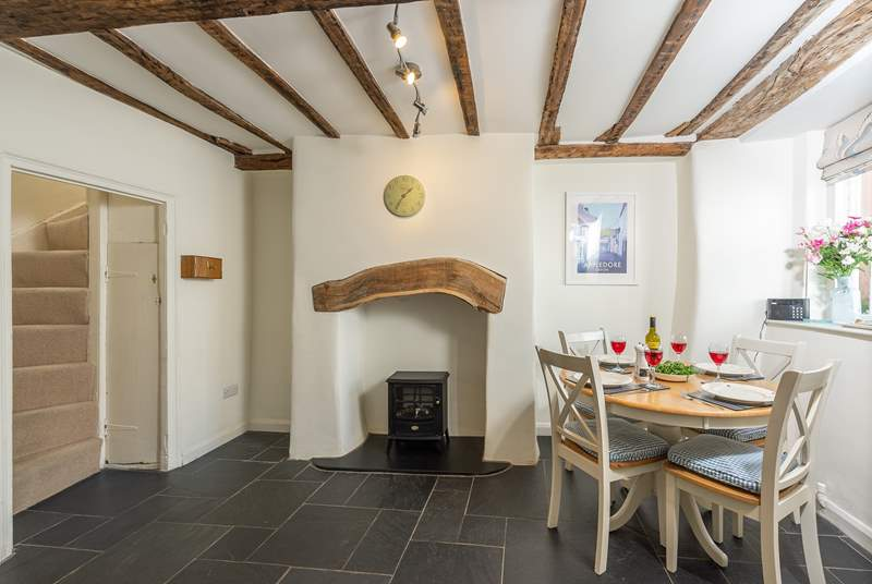The slate floor of the kitchen/dining room adds to the traditional feel but is also great for dogs after a walk along the beach.